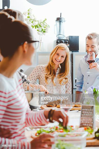 Friends cooking together in the modern kitchen