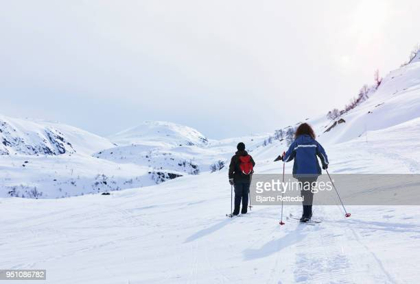 Friends cross-country skiing in the mountains