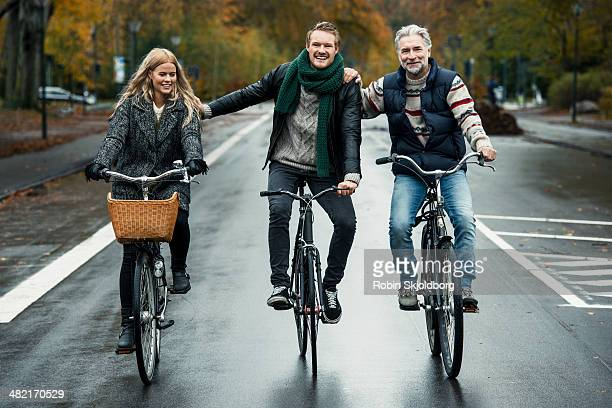 Friends cycling on street