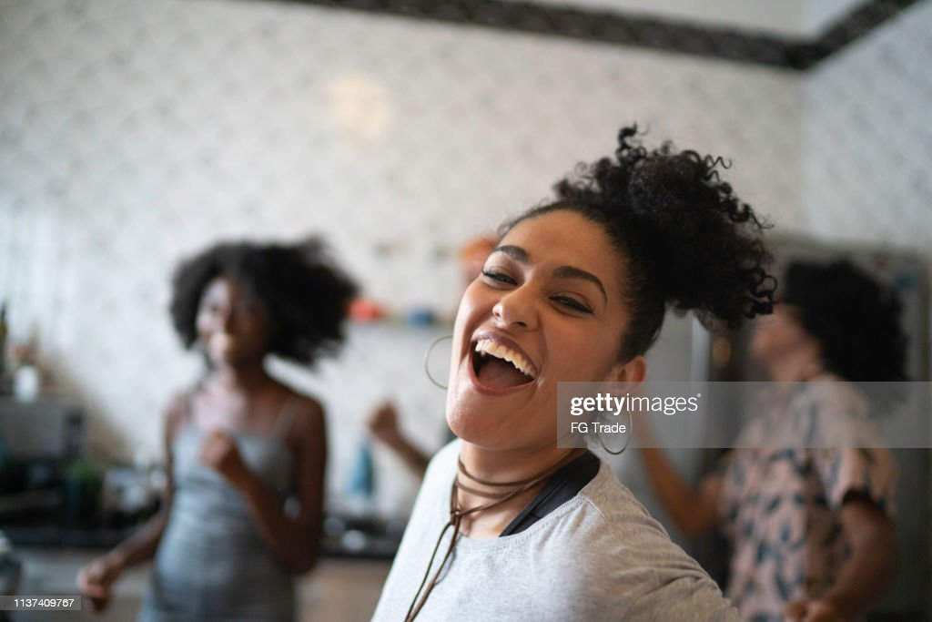 Friends dancing and having fun at kitchen : Stock Photo
