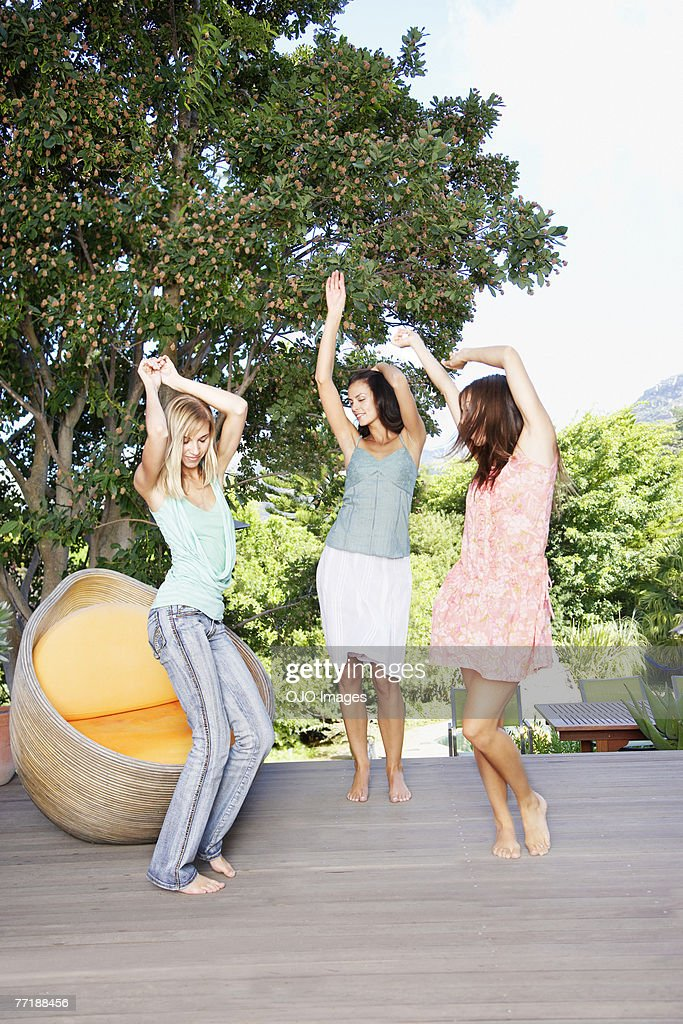 Friends dancing around on a deck : Stock Photo