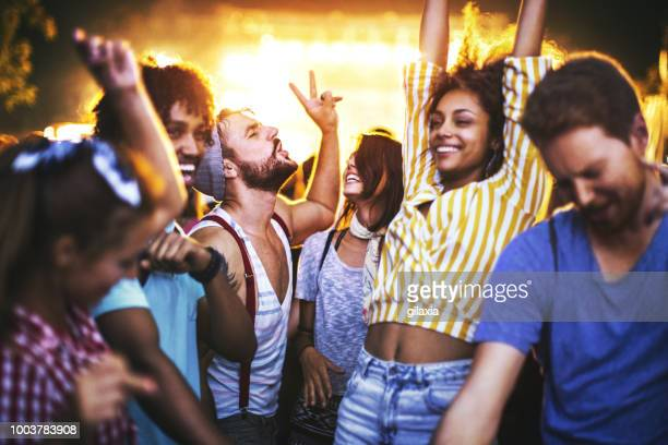 friends dancing at a concert. - party stock pictures, royalty-free photos & images