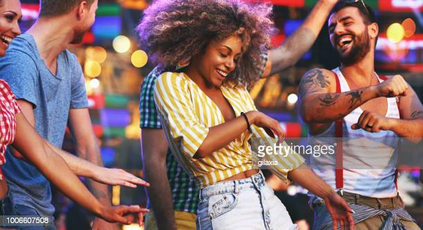 friends dancing at a concert. - sexy young women stock pictures, royalty-free photos & images