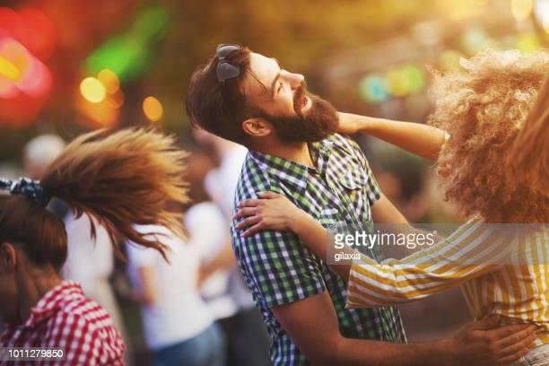Friends dancing at a concert.