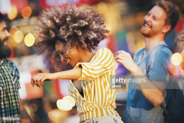 friends dancing at a concert. - music festival stock pictures, royalty-free photos & images
