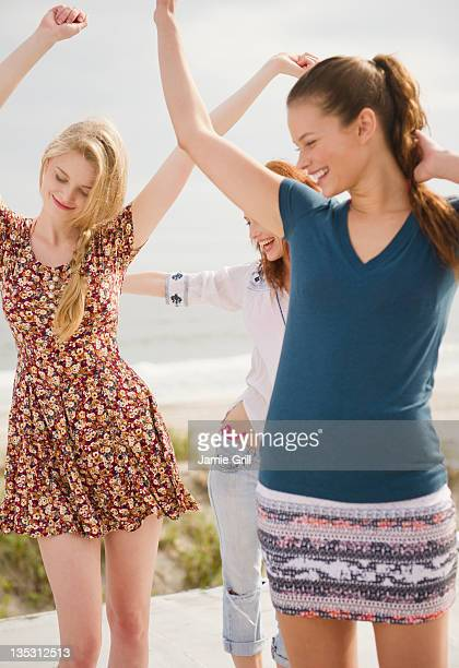 Friends dancing at beach party