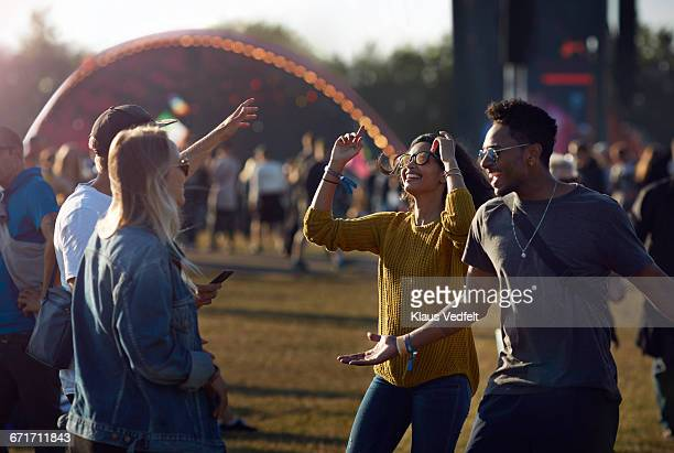 friends dancing at concert outside - festival or friendship not school not business stock photos and pictures