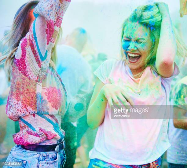 friends dancing at music festival, holi powder - holi stock pictures, royalty-free photos & images