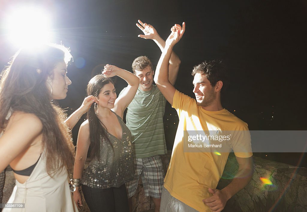 Friends dancing at night at a party. : Stock-Foto