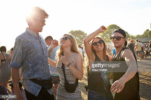 Friends dancing at outside concert