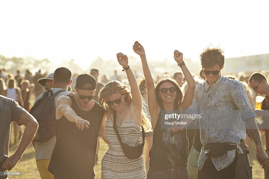 Friends dancing at outside concert : Stock Photo