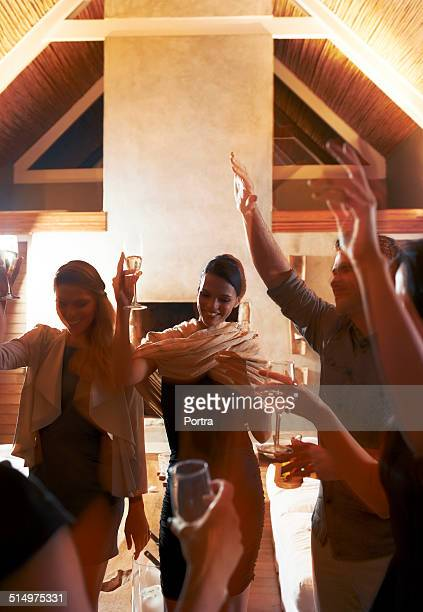Friends dancing at party in tourist resort