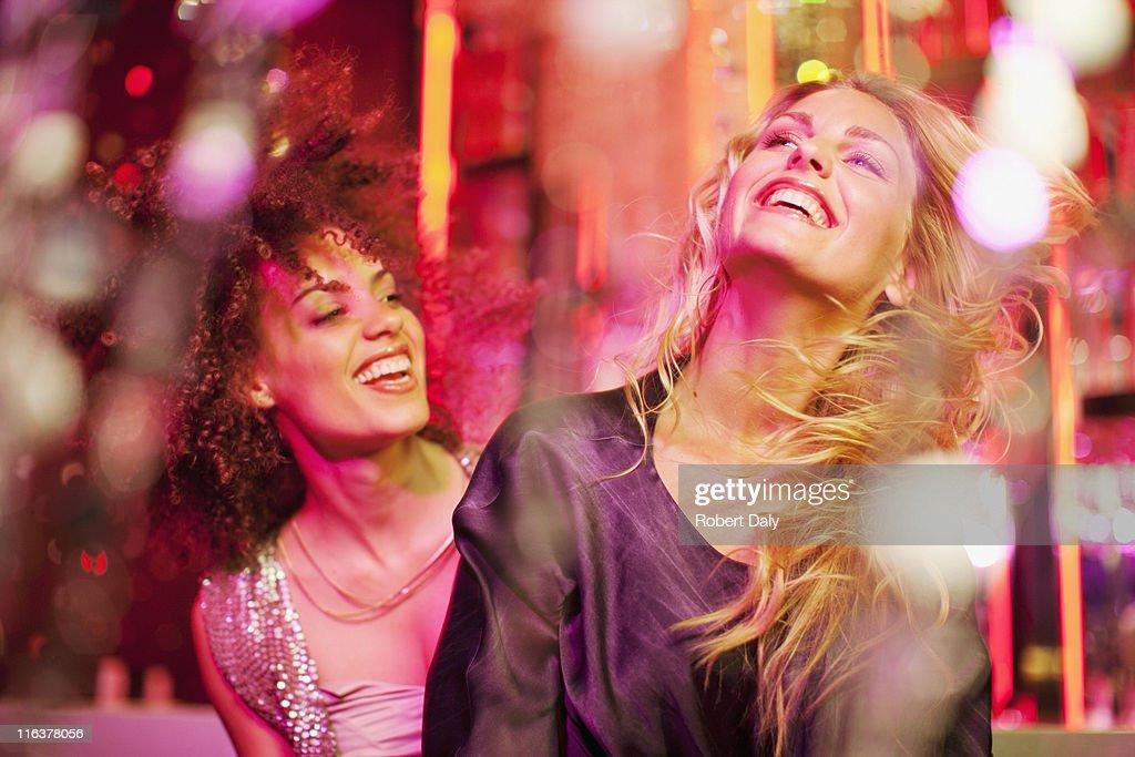 Friends dancing in nightclub : Stock Photo