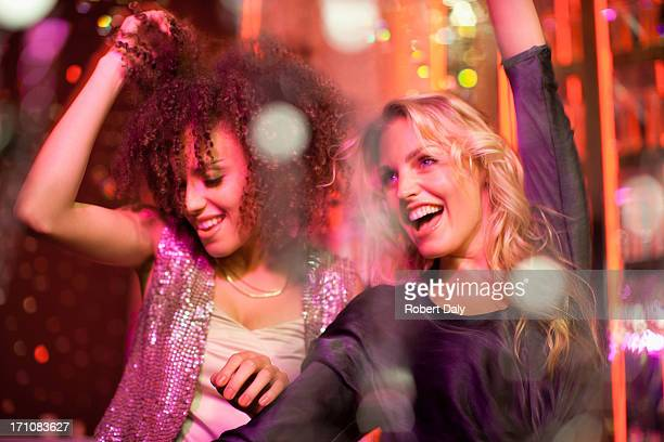 friends dancing in nightclub - mid adult women stock pictures, royalty-free photos & images