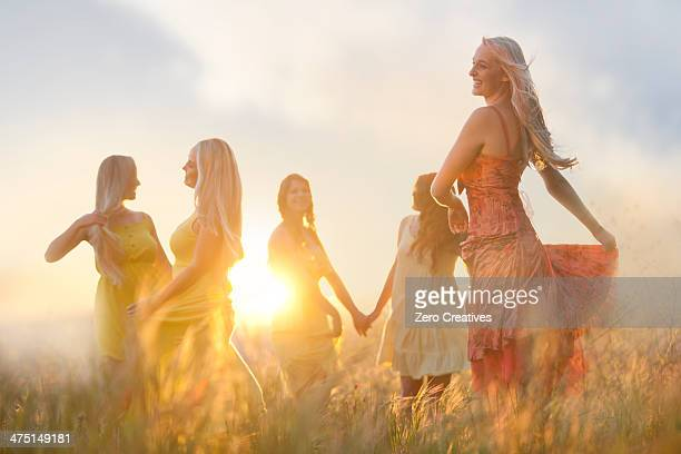 friends dancing on meadow - sundress stock pictures, royalty-free photos & images
