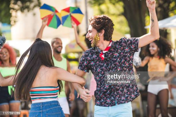 friends dancing on the street - dance troupe stock photos and pictures