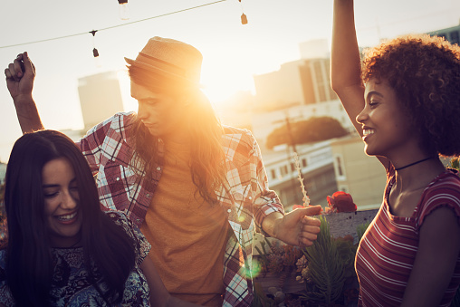 Friends dancing on urban rooftop - gettyimageskorea