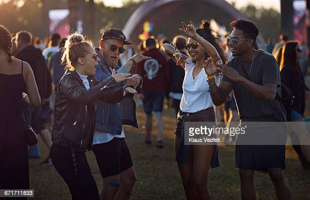 friends dancing together at big festival - music festival ストックフォトと画像