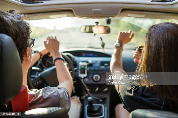 friends dancing while on a road trip during beautiful summer day - canada stock pictures, royalty-free photos & images