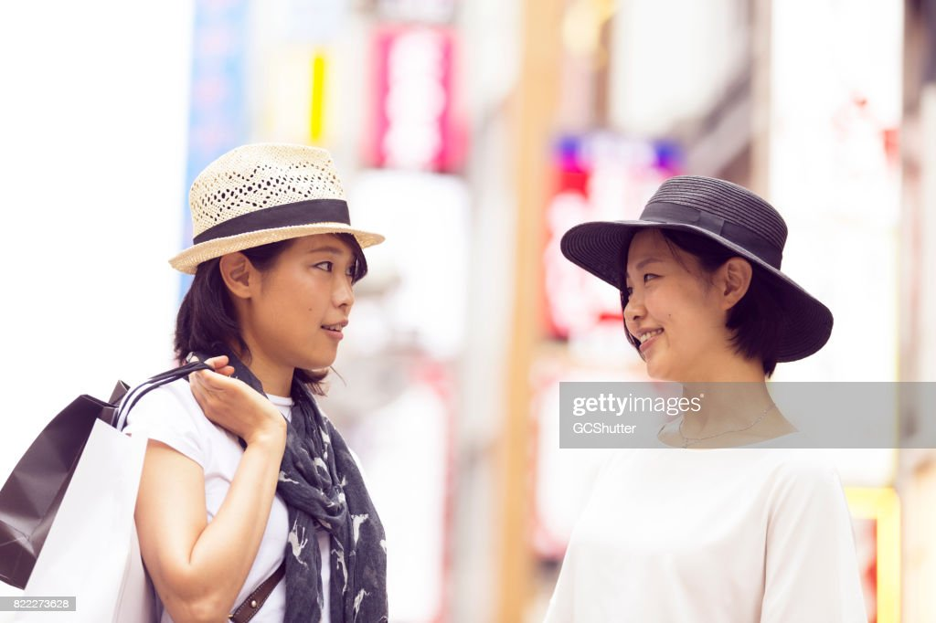 Friends deciding on where to go next after their shopping spree : Stock Photo