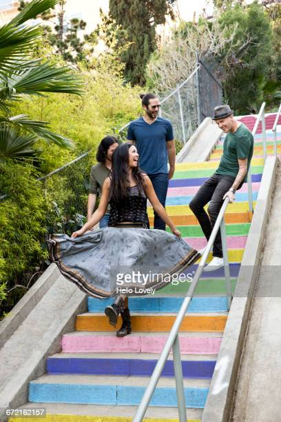 Friends descending multicolor staircase