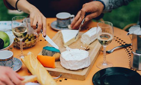 Friends dining in the suburban garden of Paris 532133356