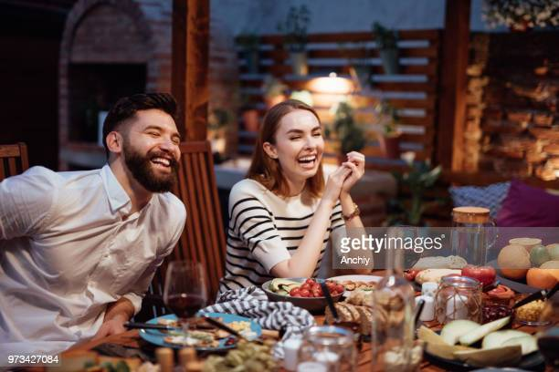 friends dining outdoor - evening meal stock pictures, royalty-free photos & images