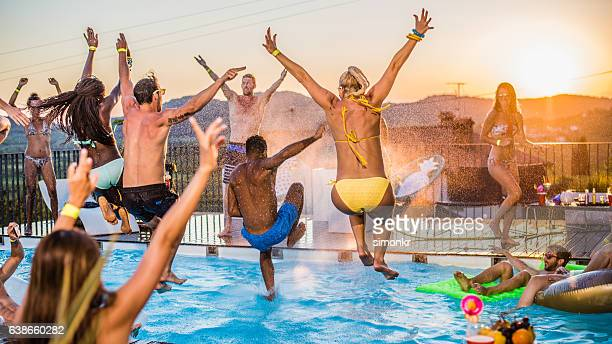 Friends diving into pool
