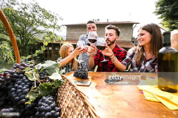 friends do a wine tasting in the vineyard - chianti region stock photos and pictures