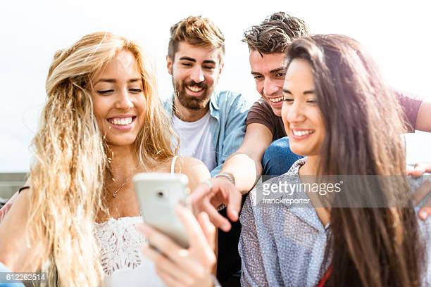 friends doing a selfie portrait outdoors - allegro foto e immagini stock