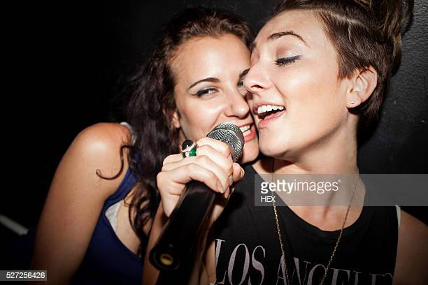 friends doing karaoke - karaoke stock pictures, royalty-free photos & images