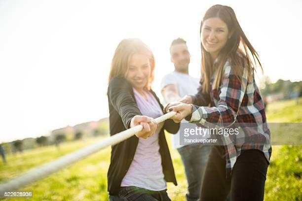 Friends doing the Tug of war - teamwork
