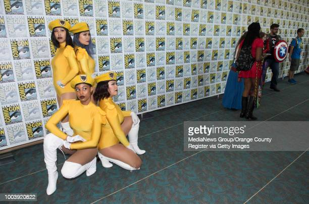 Friends dressed as Beyonce's backup singers from her Coachella appearance pose for photos during the first day of ComicCon 2018 in San Diego on...