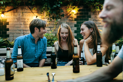 Friends Drinking And Having A Laugh Together Before Eating Dinner - gettyimageskorea