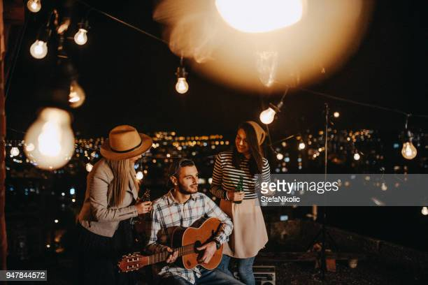 friends drinking and partying on the rooftop - individual event imagens e fotografias de stock