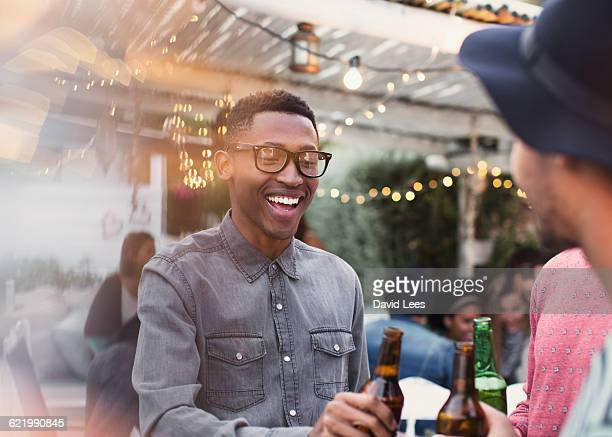 friends drinking and relaxing at poolside party - men friends beer outside stock pictures, royalty-free photos & images