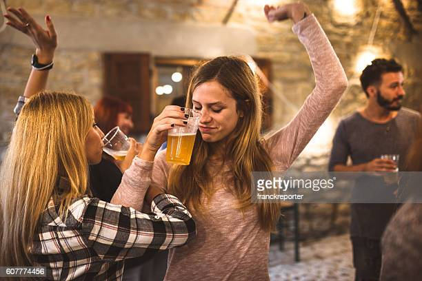 friends drinking beer at the oktoberfest