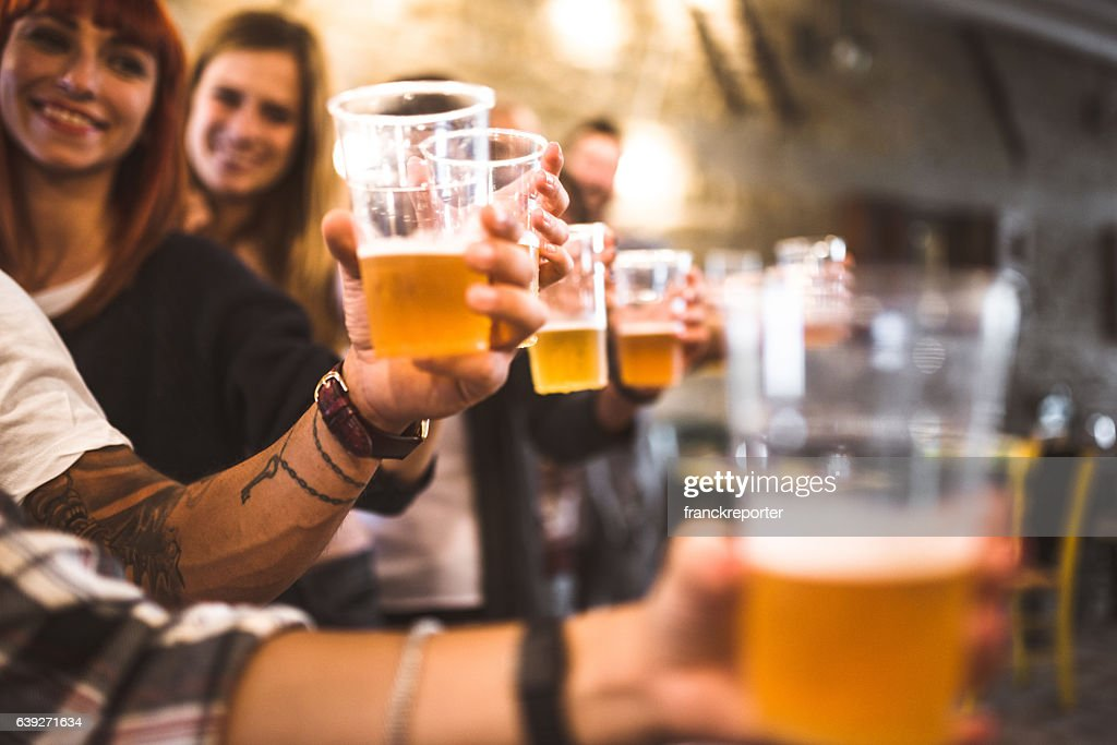 friends drinking beer at the oktoberfest : Stock Photo