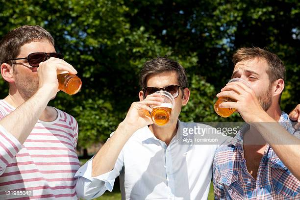 Friends Drinking Beer in a City Park