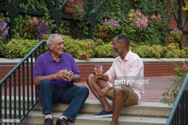 Friends drinking beer in flower garden