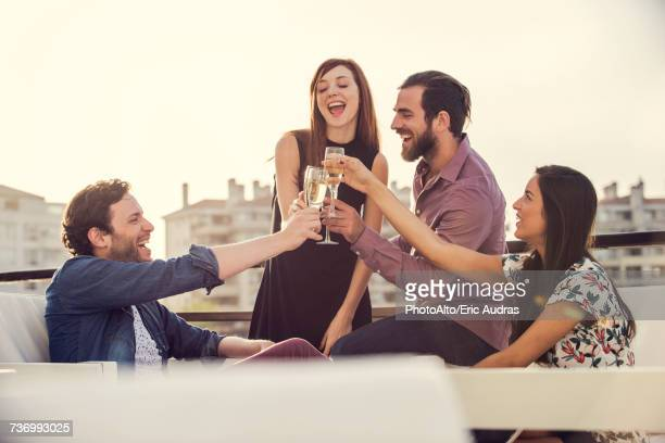 friends drinking champagne together outdoors - four people foto e immagini stock