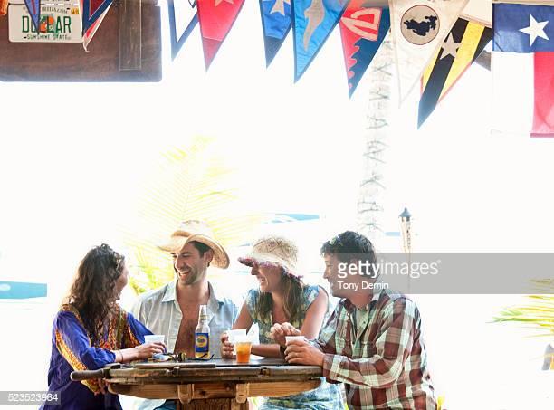 Friends drinking cocktails at beach bar