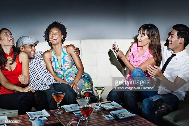 Friends drinking cocktails in nightclub