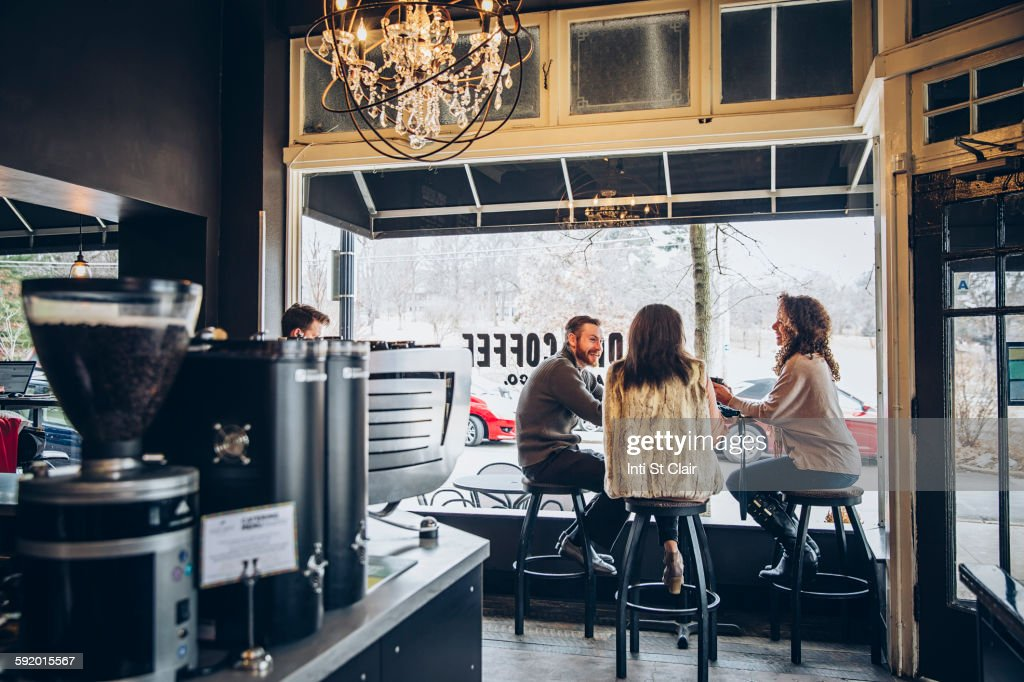 Friends drinking coffee in cafe : Stock Photo