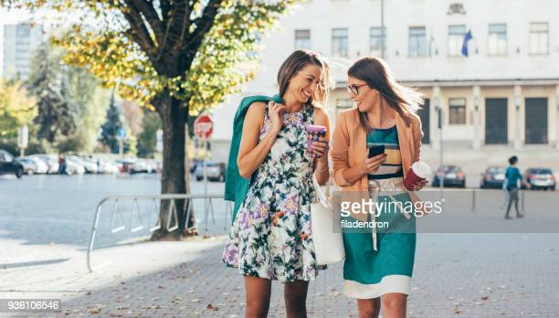 friends drinking coffee in the city - a fall from grace stock pictures, royalty-free photos & images