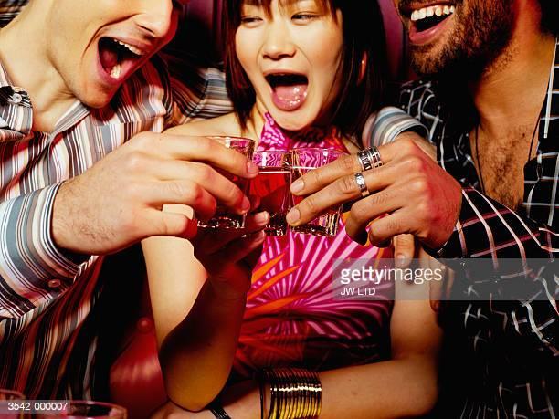 Friends Drinking in Nightclub