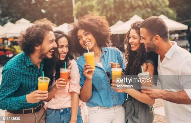 Friends drinking juice