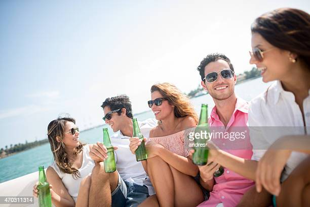 Friends drinking on a boat in the summer