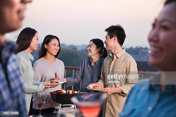 Friends Drinking on Rooftop