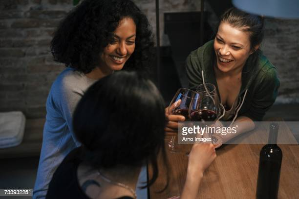 friends drinking red wine, making a toast - night in stock pictures, royalty-free photos & images